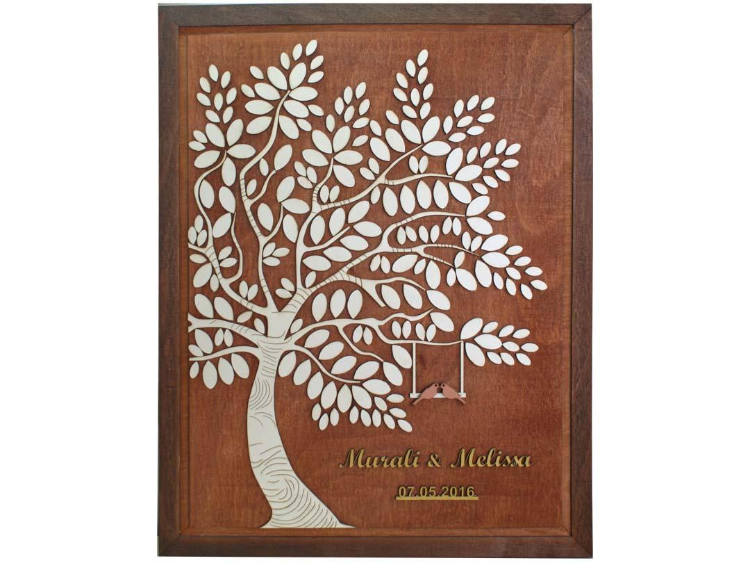 Cuadro para firmas y mensajes de boda modelo Melissa con lienzo en madera tono cristobal y marco en genizaro. Detalles decorativos en dorado. Tronco en blanco.