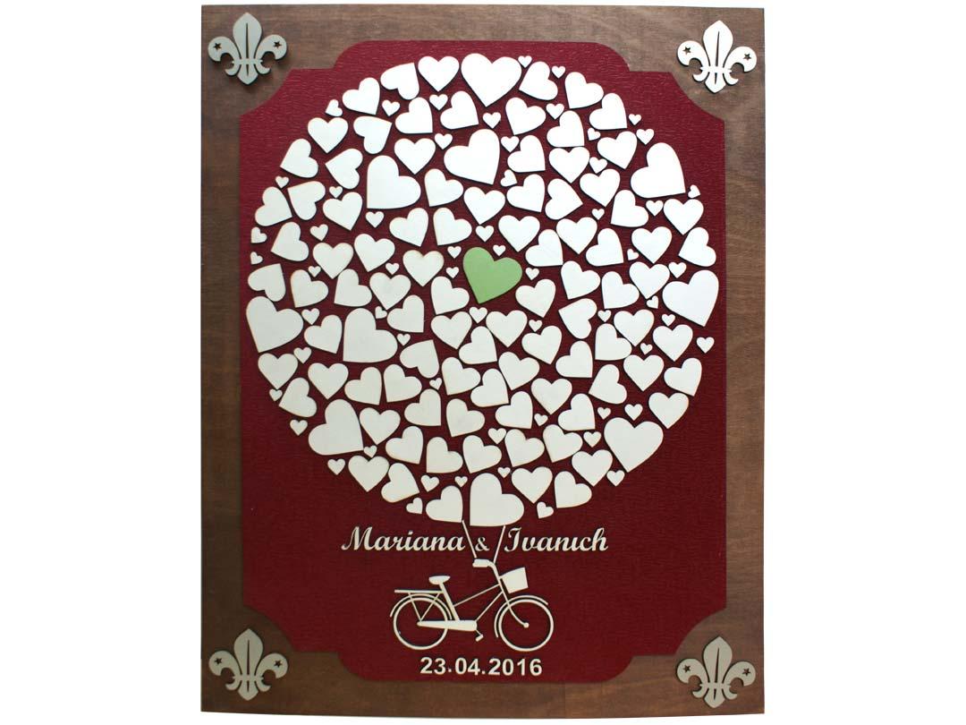 Cuadro para firmas y mensajes de boda modelo Sara, con lienzo en tela vinotinto y detalles decorativos en plata.