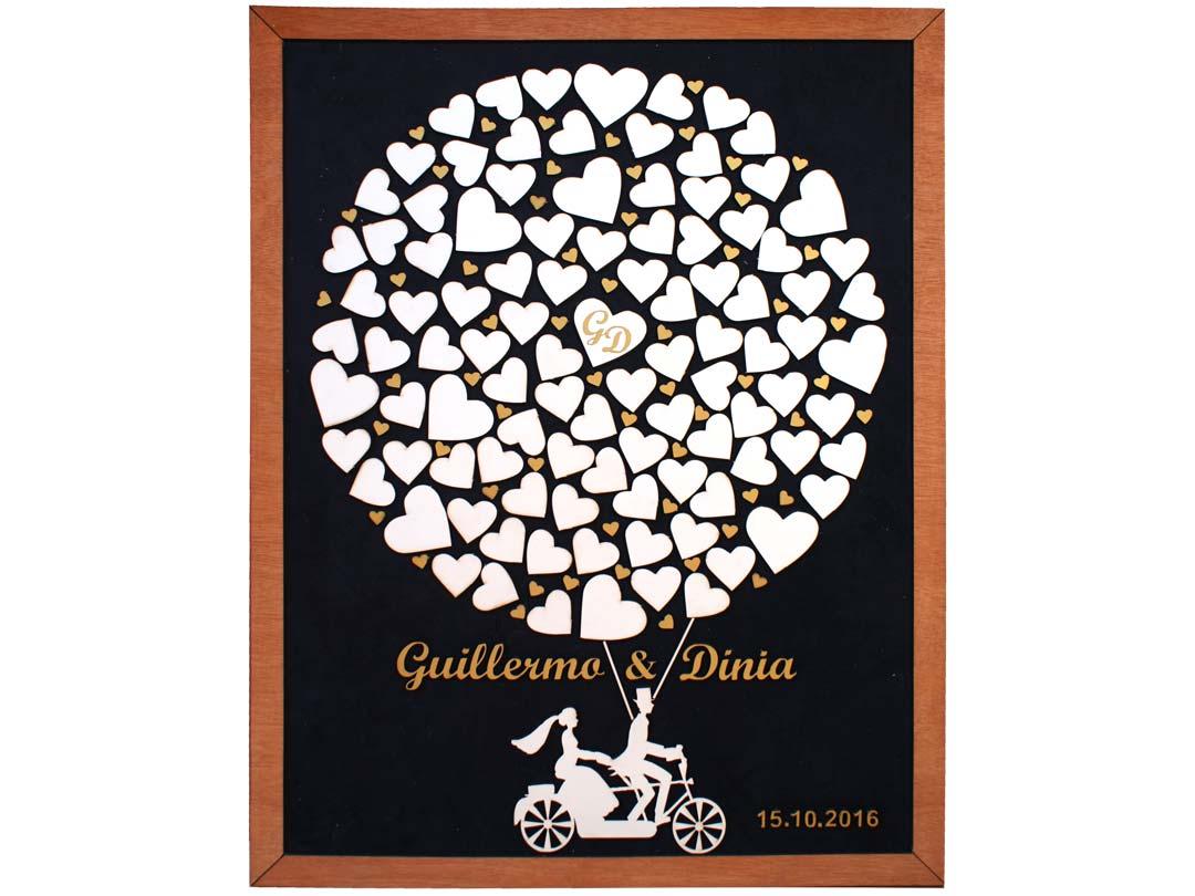 Cuadro para firmas y mensajes de boda modelo Sara, con lienzo en tela negra marco en miel y detalles decorativos en dorado. Silueta.