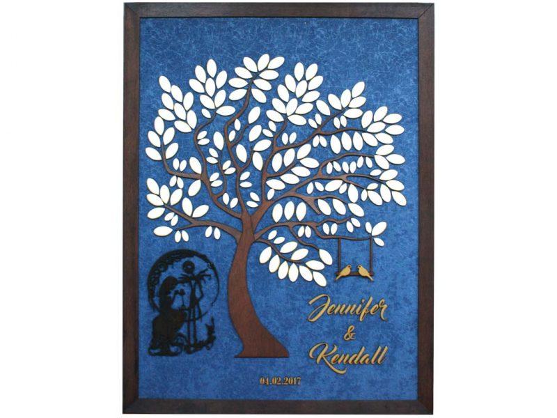 Cuadro para firmas y mensajes de boda modelo Melissa con lienzo en tela azul y marco en nogal, Detalles decorativos en dorado y silueta en negro.