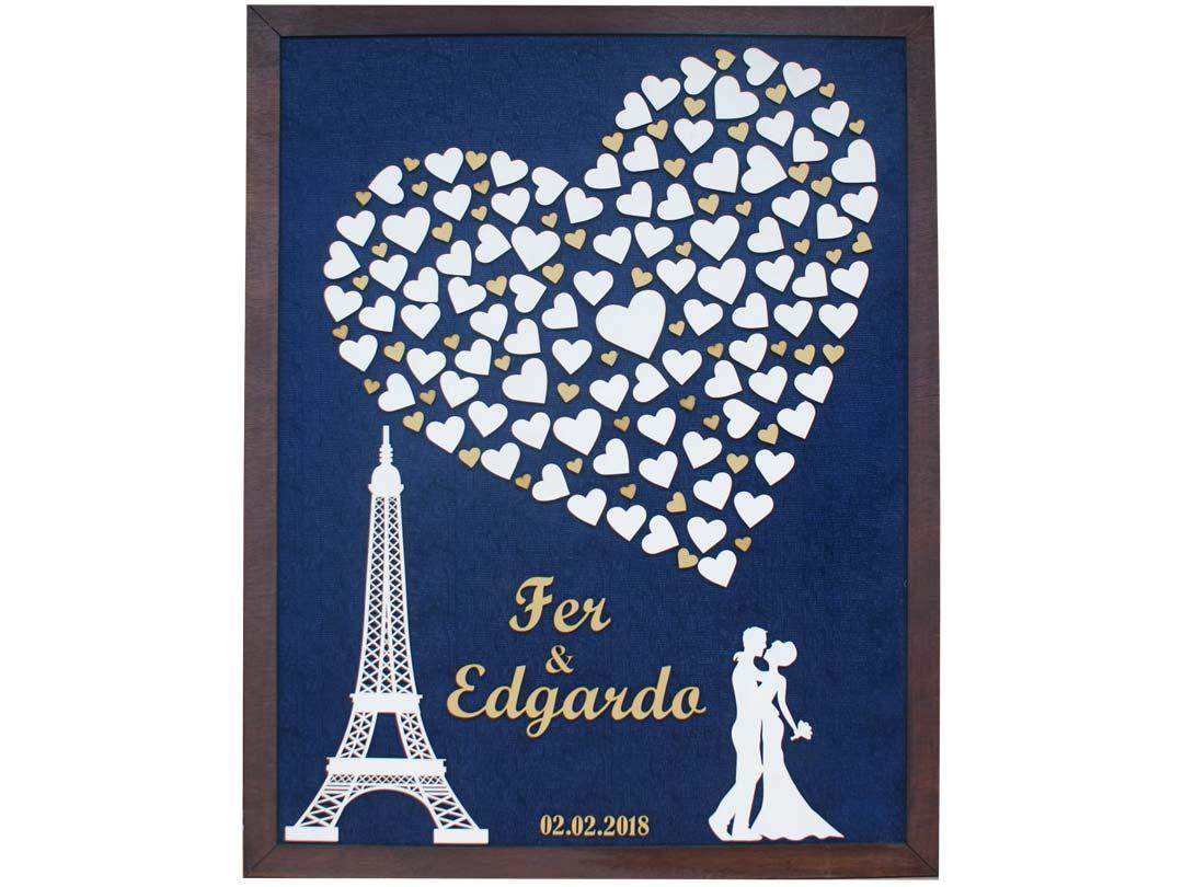 Cuadro para firmas y mensajes de boda modelo Sara, con lienzo en tela azul y detalles decorativos en dorado y blanco. Torre Eiffel.