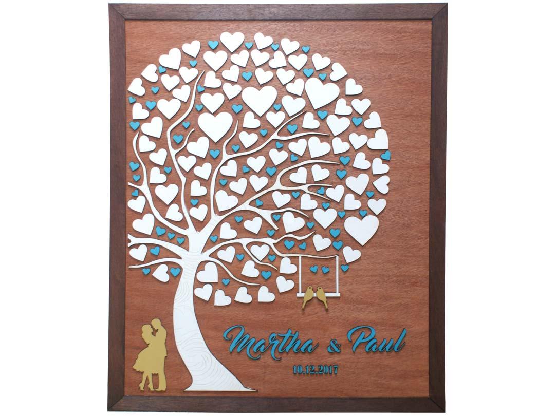 Cuadro para firmas y mensajes de boda modelo Abigail con lienzo en madera tono cristobal y marco en nogal. Detalles decorativos en dorado y turquesa.