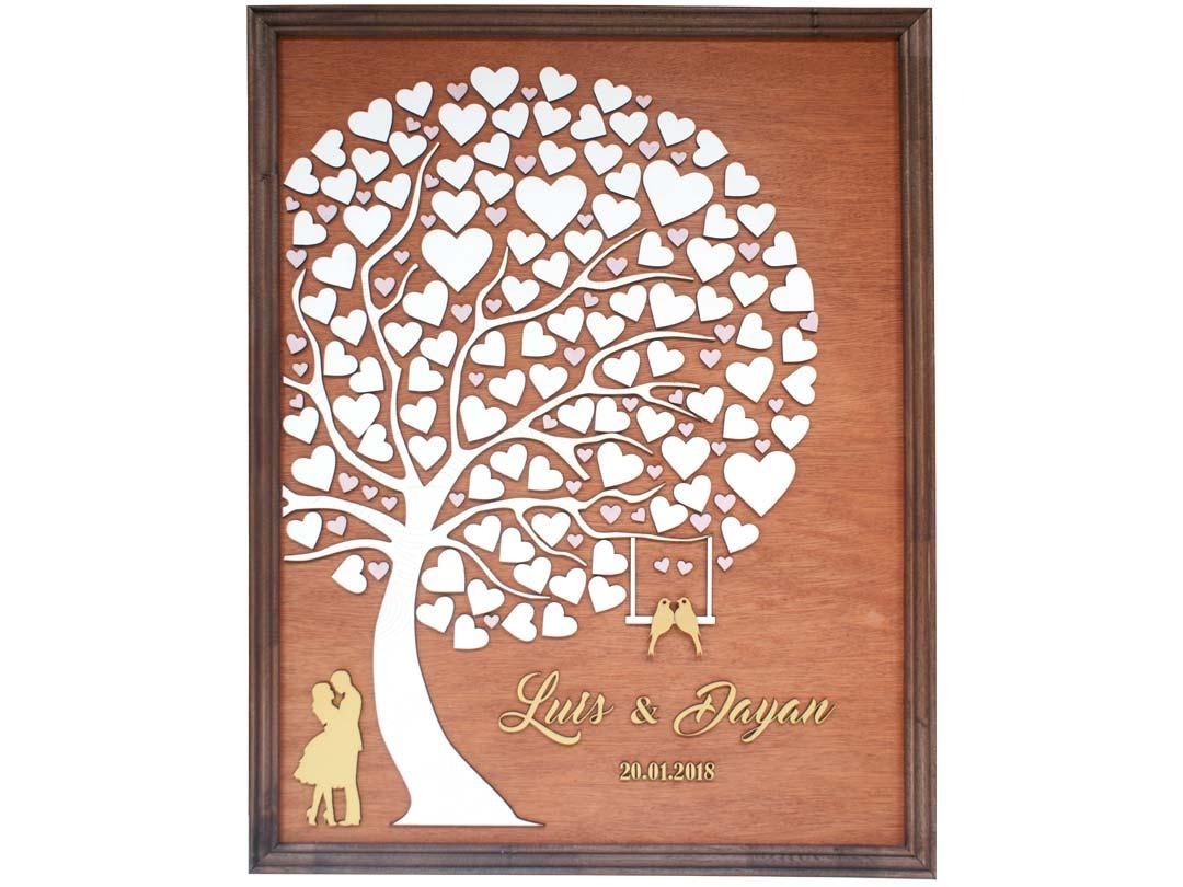 Cuadro para firmas y mensajes de boda modelo Abigail con lienzo en madera tono cristobal y marco en nogal. Detalles decorativos en dorado y rosado.